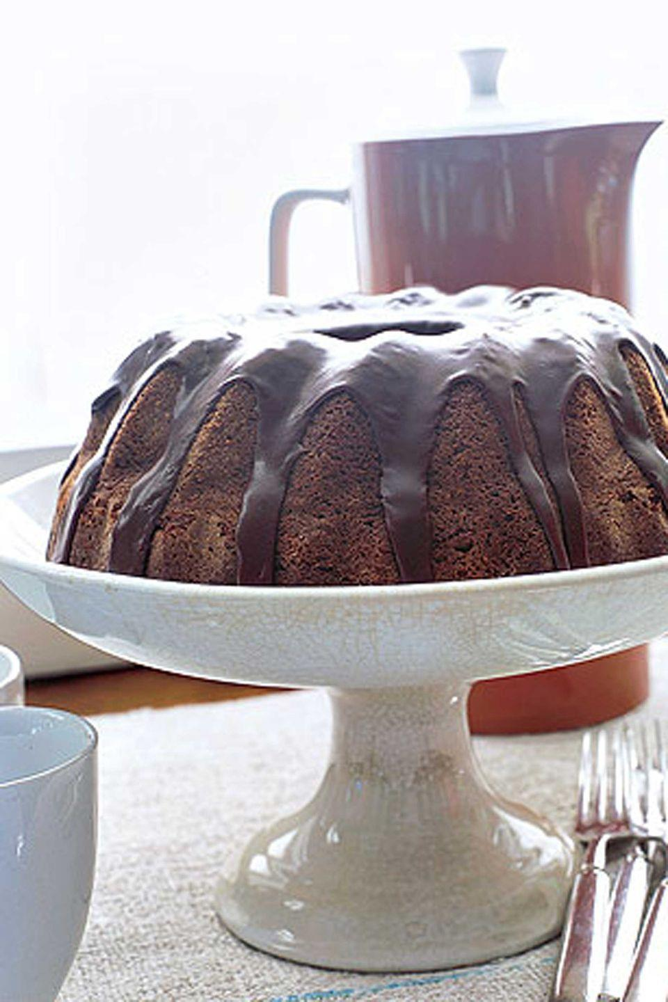 "<p>The cocoa and fresh coffee provide an added kick to a traditional applesauce cake.</p><p><strong><a href=""https://www.countryliving.com/food-drinks/recipes/a887/grandmas-applesauce-cake-2989/"" rel=""nofollow noopener"" target=""_blank"" data-ylk=""slk:Get the recipe"" class=""link rapid-noclick-resp"">Get the recipe</a>.</strong></p>"