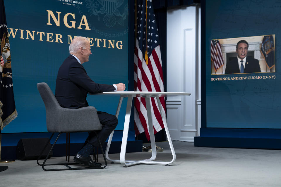 President Joe Biden listens as Gov. Andrew Cuomo, D-N.Y., speaks during a virtual meeting of the National Governors Association, in the South Court Auditorium on the White House campus, Thursday, Feb. 25, 2021, in Washington. (AP Photo/Evan Vucci)
