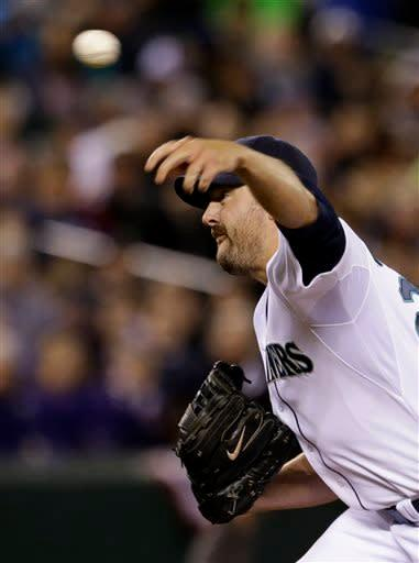 Seattle Mariners starting pitcher Joe Saunders throws against the Houston Astros in the seventh inning of a baseball game Monday, April 8, 2013, in Seattle. (AP Photo/Elaine Thompson)