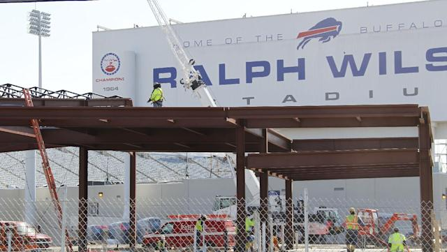 Work continues on the renovation of Ralph Wilson Stadium, home of the NFL football team Buffalo Bills, in Orchard Park, N.Y., Thursday, April 10, 2014. The new team store is being constructed in the foreground. Don't rule out Niagara Falls as a potential future home of the Bills. Several officials told The Associated Press that a newly formed Bills stadium task force of public and private leaders seeking to bolster the team's long-term viability is considering sites that would put it closer to the team's burgeoning Ontario fan base. The stadium is currently undergoing $130 million in upgrades. (AP Photo/Bill Wippert)