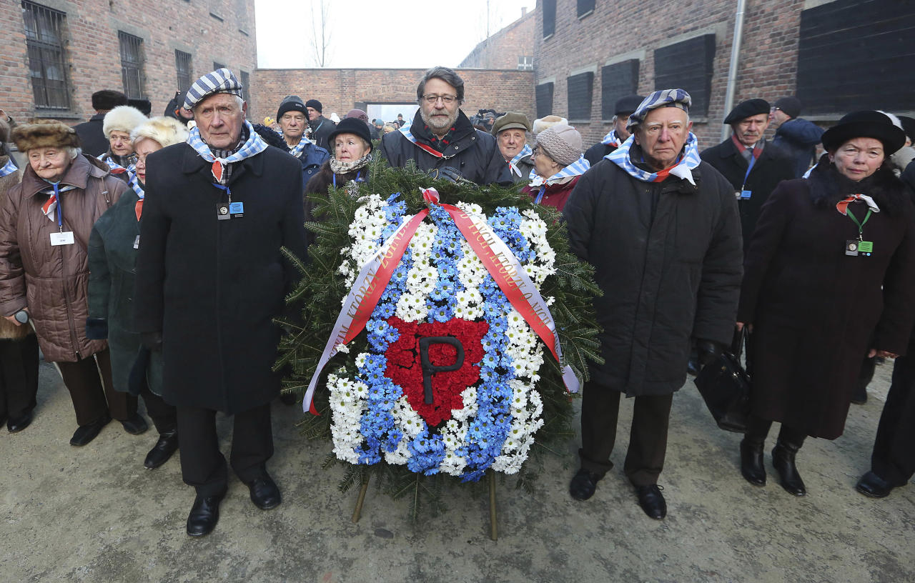 <p>Holocaust survivors commemorate the people killed by the Nazis at the former Auschwitz Germany Nazi death camp in Oswiecim, Poland, Friday, Jan. 27, 2017, on the International Holocaust Remembrance Day that marks the liberation of the Auschwitz Nazi death camp on Jan. 27, 1945. (Photo: Czarek Sokolowski/AP) </p>
