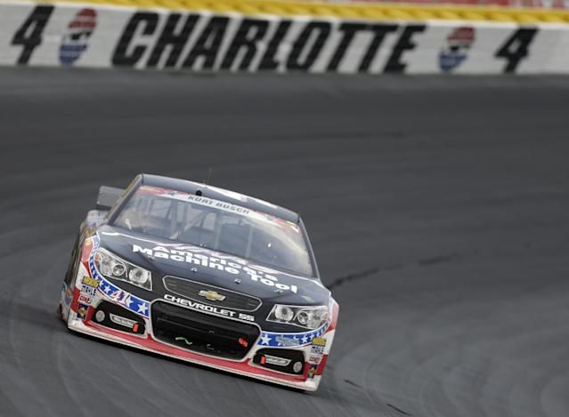 Kurt Busch (41) drives his car out of Turn 4 during the NASCAR Sprint Cup series Coca-Cola 600 auto race at Charlotte Motor Speedway in Concord, N.C., Sunday, May 25, 2014. (AP Photo/Chuck Burton)