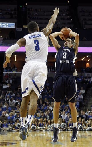 North Florida guard Parker Smith (3) goes to the basket against Memphis guard Chris Crawford (3) during the first half of an NCAA preseason college basketball game on Monday, Nov. 12, 2012, in Memphis, Tenn. (AP Photo/Lance Murphey)