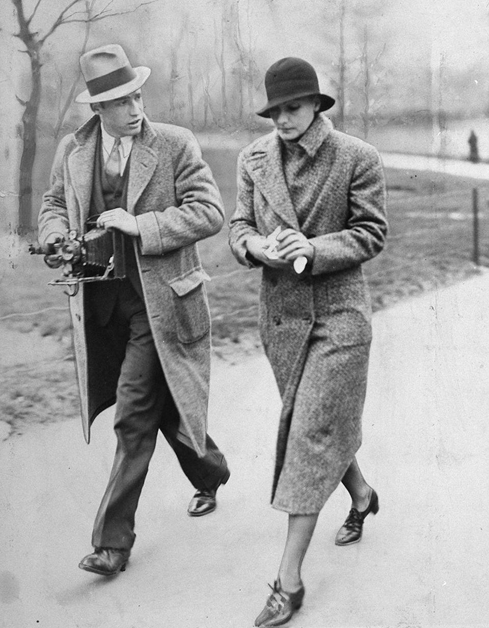 <p>Swedish actress Greta Garbo being harried by a reporter as she walks through Central Park in New York City. </p><p>Other celebrity visitors this year: actress and singer June MacCloy, actor Johnny Walker.<br></p>
