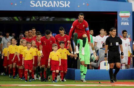 Soccer Football - World Cup - Group B - Iran vs Portugal - Mordovia Arena, Saransk, Russia - June 25, 2018 Portugal's Cristiano Ronaldo walks on to the pitch before the match REUTERS/Ivan Alvarado