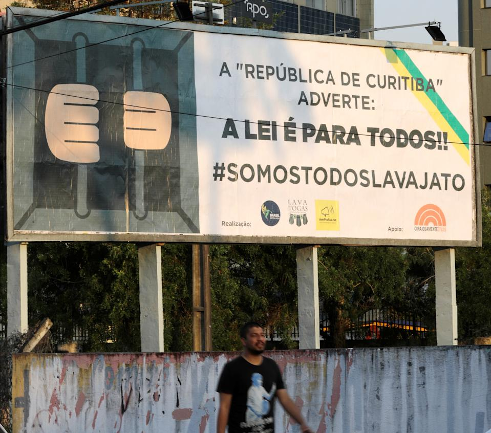 "A man walks past by a banner which reads: ""The republic of Curitiba warns: The law is for everyone #we are all lava jato"" in a street in Curitiba, Brazil September 12, 2017. REUTERS/Paulo Whitaker"