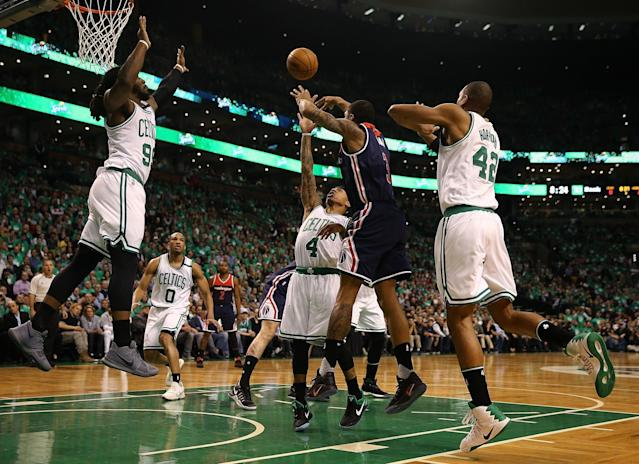 <p>BOSTON, MA – MAY 15: Isaiah Thomas #4, Jae Crowder #99 and Al Horford #42 of the Boston Celtics defend against Bradley Beal #3 of the Washington Wizards during Game Seven of the NBA Eastern Conference Semi-Finals at TD Garden on May 15, 2017 in Boston, Massachusetts. NOTE TO USER: User expressly acknowledges and agrees that, by downloading and or using this photograph, User is consenting to the terms and conditions of the Getty Images License Agreement. (Photo by Elsa/Getty Images) </p>