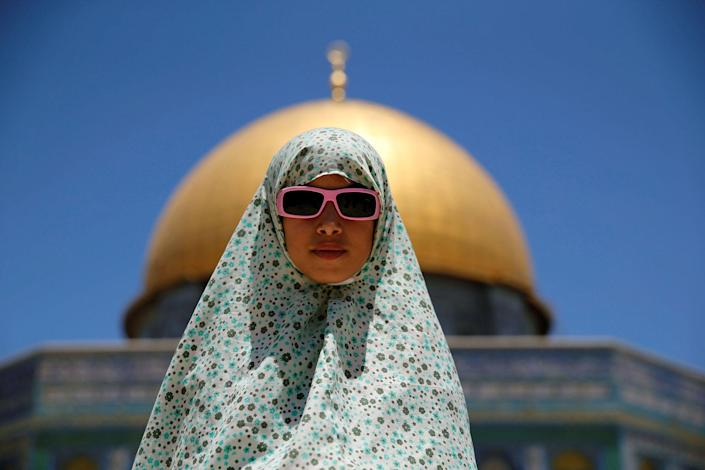 <p>A Palestinian girl prays on the last Friday of the holy fasting month of Ramadan on the compound known to Muslims as Noble Sanctuary and to Jews as Temple Mount in Jerusalem's Old City July 1, 2016. (Photo: Ammar Awad/REUTERS) </p>