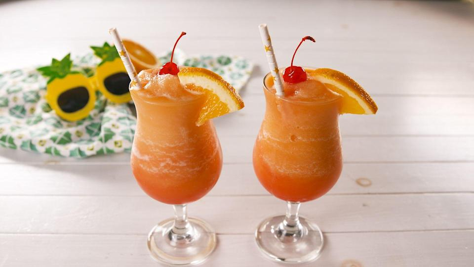 """<p>This is a mashup of our two favorite tequila cocktails that cannot be missed!</p><p>Get the recipe from <a href=""""https://www.delish.com/cooking/recipe-ideas/a28554448/frozen-tequila-sunrise-margarita-recipe/"""" rel=""""nofollow noopener"""" target=""""_blank"""" data-ylk=""""slk:Delish"""" class=""""link rapid-noclick-resp"""">Delish</a>.</p>"""