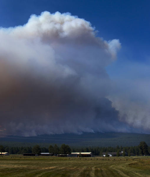 A wildfire burns just outside of Sister, Ore., Friday Aug. 18, 2017. (Chris Pietsch/The Register-Guard via AP)