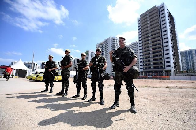 Brasilian soldiers stand guard near the Olympic Village in Rio de Janeiro, on August 4, 2016, ahead of the Rio 2016 Olympic Games (AFP Photo/Franck Fife)