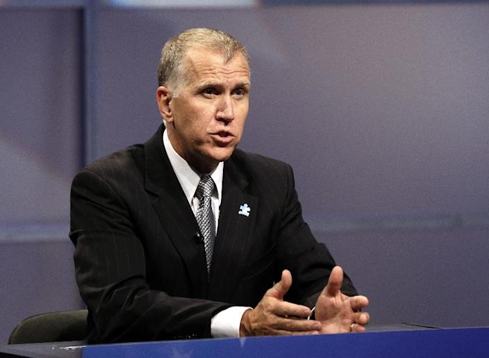 In this April 23, 2014, photo, Republican senatorial candidate Thom Tillis responds during a televised debate at WRAL television studios in Raleigh, N.C. The U.S. Chamber of Commerce is launching ads this week in North Carolina and Georgia in a crunch-time effort to help establishment-backed Republicans in crowded Senate primaries and pumping money into commercials praising GOP hopefuls in Michigan, Montana and Alaska. The North Carolina primary is May 6, Georgia two weeks later. The Chamber will begin airing ads Wednesday for Tillis and Georgia Rep. Jack Kingston. (AP Photo/Gerry Broome, Pool)