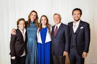 <p>Here, King Abdullah II and his wife Queen Rania (second left) are photographed alongside their children, Princess Salma, Prince Al Hussein (right) and Prince Hashem (left).<em> [Photo: Getty]</em> </p>