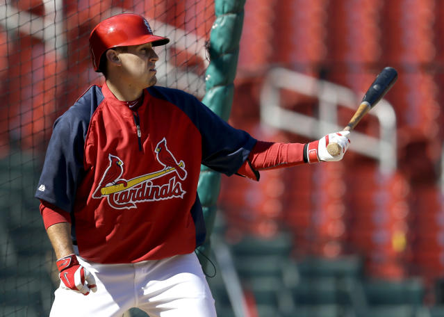 St. Louis Cardinals' Allen Craig bats during baseball practice Sunday, Oct. 20, 2013, in St. Louis. Craig, who hasn't played since Sept. 4 because a left mid-foot sprain missing both the National League division and championship series, insists he will be ready when the Cardinals begin play in the World Series against the Boston Red Sox on Wednesday in Boston. (AP Photo/Jeff Roberson)