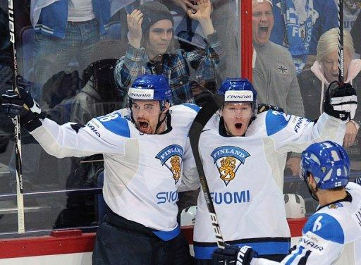 Finnish players celebrate scoring against team USA