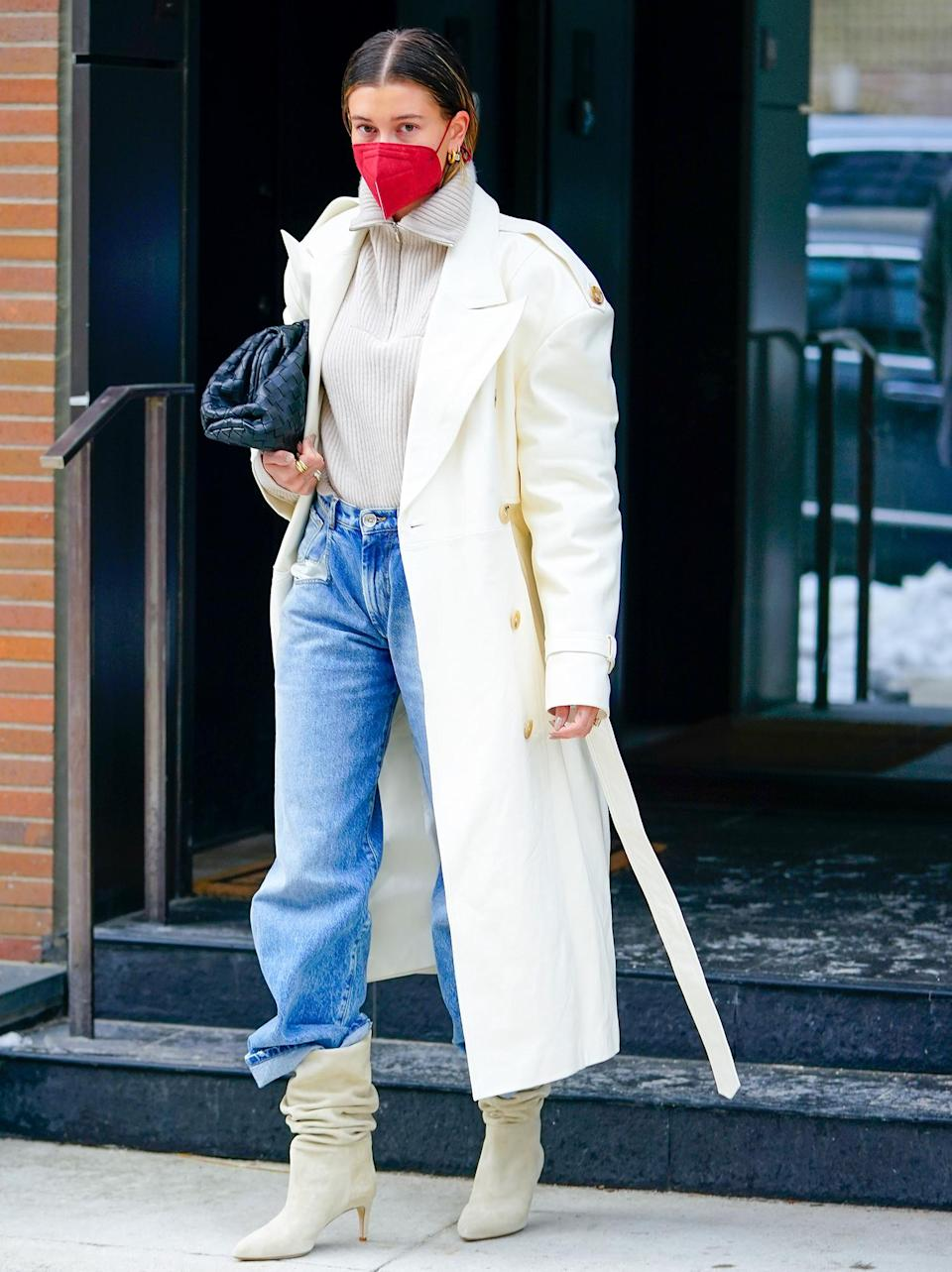 <p>Hailey Bieber looks incredibly chic in a long white coat, jeans and slouchy boots while headed to the studio in N.Y.C. on Monday.</p>