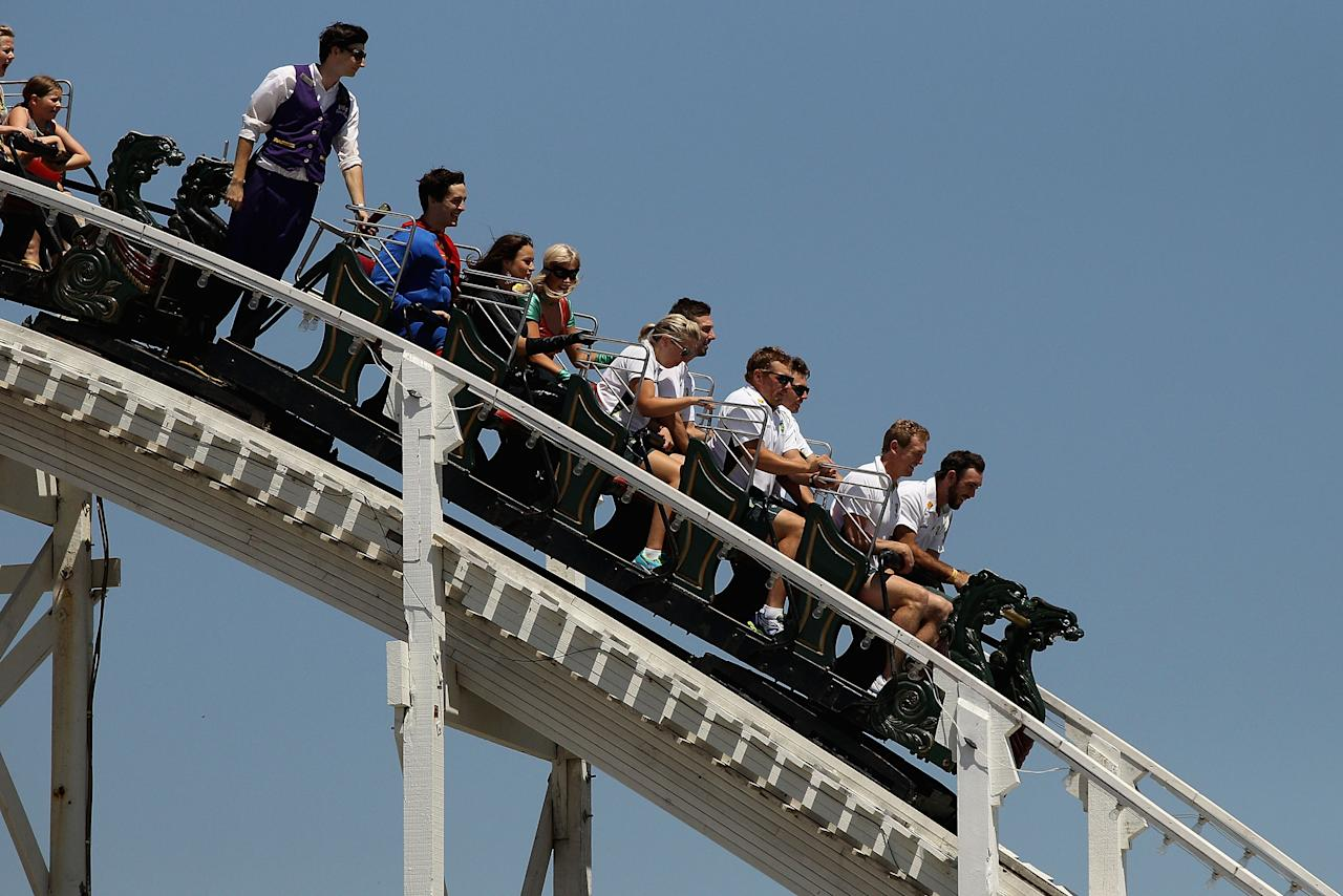 MELBOURNE, AUSTRALIA - JANUARY 10:  Aaron Finch, George Bailey, Glenn Maxwell, James Pattinson and Shaun Marsh ride the scenic railway during the One Day International Series launch at Luna Park on January 10, 2014 in Melbourne, Australia.  (Photo by Robert Prezioso/Getty Images)