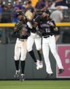 From left, Colorado Rockies left fielder Raimel Tapia, center fielder Yonathan Daza and right fielder Charlie Blackmon celebrate the team's 7-3 over the Milwaukee Brewers in a baseball game Thursday, June 17, 2021, in Denver. (AP Photo/David Zalubowski)