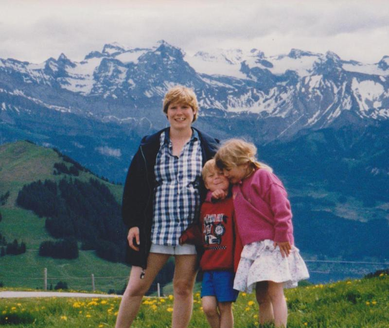 6-year-old me (right), on a mountain in a dress