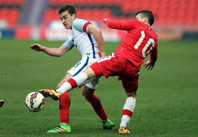 DONCASTER, ENGLAND - MARCH 27: Harry Winks of England (L) challenged by Marco Bustos of Canada during the U20 International Friendly match between England and Canada at the Keepmoat Stadium on March 27, 2016 in Doncaster, England. (Photo by Nigel Roddis/Getty Images)