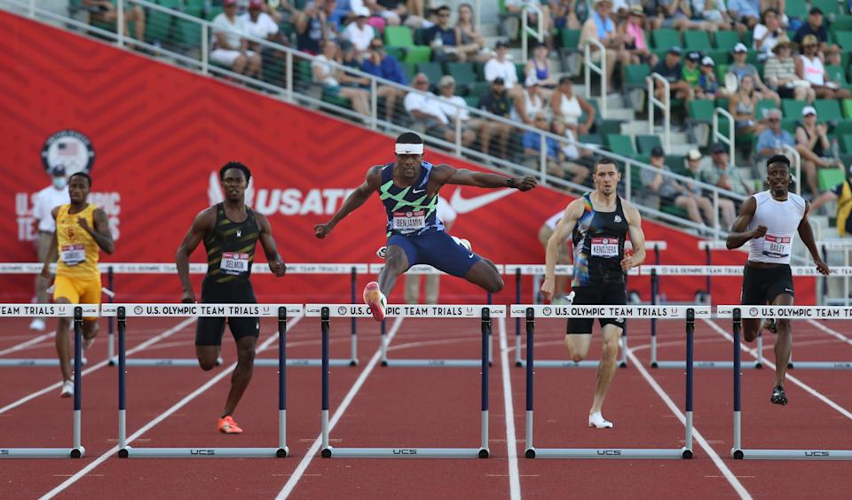 Rai Benjamin, center, clears the last hurdle during the  men's 400 meter hurdle to win the gold during the U.S. Olympic Track and Field Trials at Hayward Field.