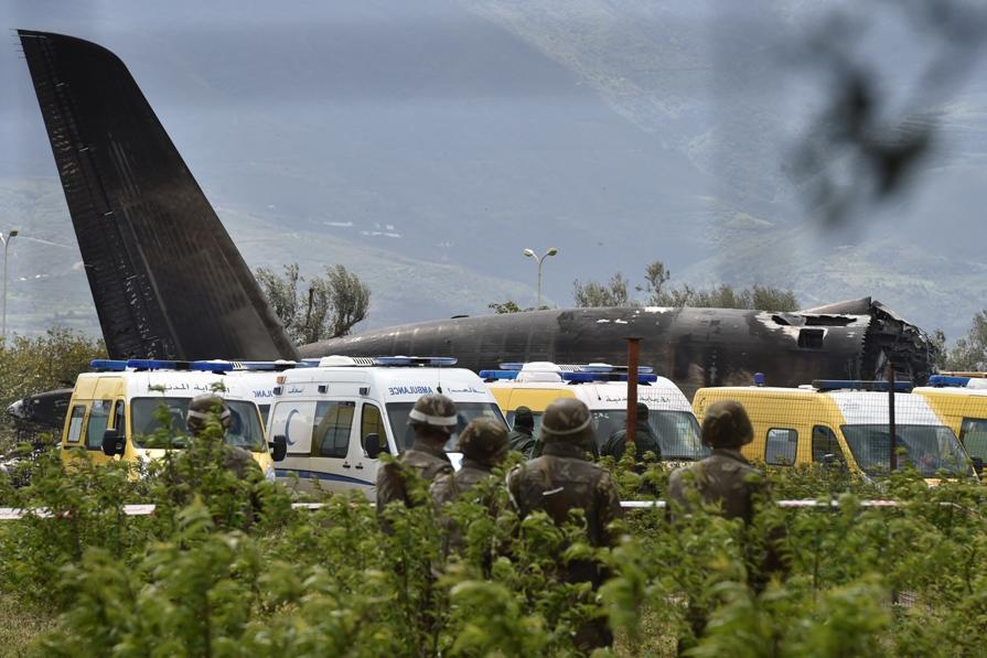 <p>Rescuers and security forces are seen around the wreckage of an Algerian army plane which crashed near the Boufarik airbase from where the plane had taken off on April 11, 2018. The Algerian military plane crashed and caught fire killing 257 people, mostly army personnel and members of their families, officials said. / AFP PHOTO / RYAD KRAMDI (Photo credit should read RYAD KRAMDI/AFP/Getty Images) </p>