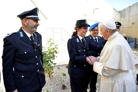 Pope Francis greets prison officers as he arrives at the Paliano prison, south of Rome, Italy April 13, 2017. Osservatore Romano/Handout via REUTERS        ATTENTION EDITORS - THIS PICTURE WAS PROVIDED BY A THIRD PARTY. EDITORIAL USE ONLY. NO RESALES. NO ARCHIVE