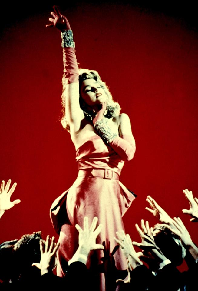 """Pop legend Madonna's most iconic video is based on Monroe's performance of """"Diamonds Are a Girl's Best Friend"""" in the 1953 movie """"Gentlemen Prefer Blondes."""" Madge emulated Monroe's look in a fitted pink dress, piles of diamonds, and made sure to surround herself with a circle of men in tuxedos. Still, Madonna dismissed the idea that she was like Monroe back in 1992. """"The main thing that we have in common is that we bleach our hair. She's a 'sex symbol' and a 'sex goddess' and I can relate to that in terms of how many people like to see me,"""" she explained to <em>Smash</em> magazine. """"I kind of like to take that imagery and what everybody's preconceived notions of what a sex goddess is supposed to be and turn it all around. Throw it back in your face and say, 'Yes, I can be this sex symbol, but I don't have to be a victim, and I don't have to be fragile.'"""""""