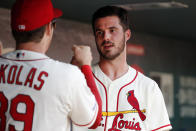 St. Louis Cardinals starting pitcher Dakota Hudson, right, is congratulated by teammate Miles Mikolas after being removed during the eighth inning in the first baseball game of a doubleheader against the Cincinnati Reds Saturday, Aug. 31, 2019, in St. Louis. (AP Photo/Jeff Roberson)