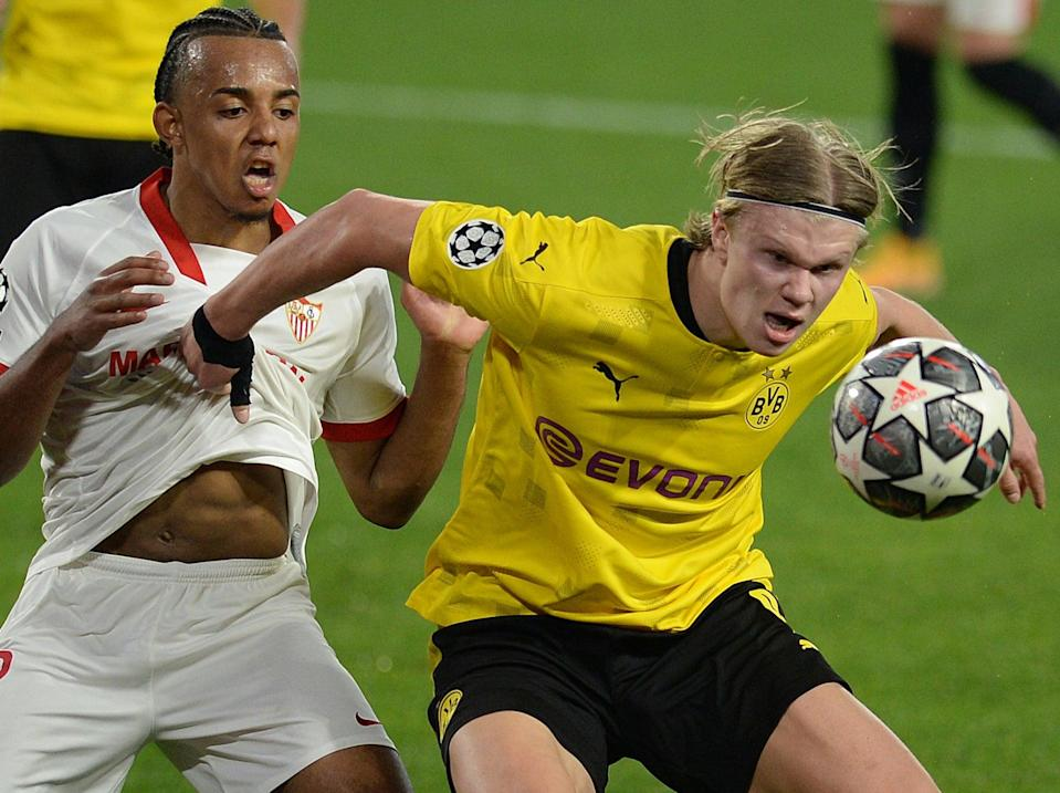 Borussia Dortmund's Erling Haaland (right) vies with Sevilla's Jules Kounde (AFP via Getty Images)