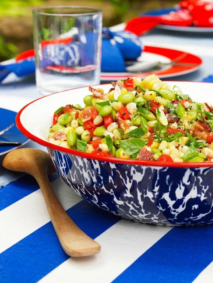 """<p>This bean salad is just 157 calories per serving, so pile it onto your plate.</p><p><em><strong><a href=""""https://www.womansday.com/food-recipes/food-drinks/recipes/a50975/edamame-bacon-succotash/"""" rel=""""nofollow noopener"""" target=""""_blank"""" data-ylk=""""slk:Get the Edamame and Bacon Succotash recipe."""" class=""""link rapid-noclick-resp"""">Get the Edamame and Bacon Succotash recipe.</a></strong></em></p>"""