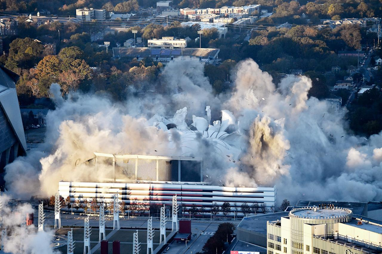 <p>The Georgia Dome is destroyed in a scheduled implosion Monday, Nov. 20, 2017, in Atlanta. The dome was not only the former home of the Atlanta Falcons but also the site of two Super Bowls, 1996 Olympics Games events and NCAA basketball tournaments among other major events. (AP Photo/Mike Stewart) </p>