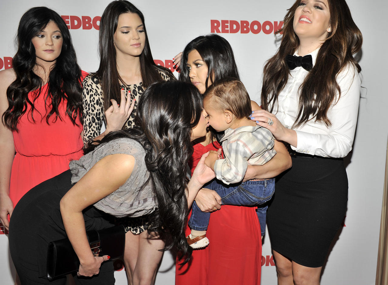 WEST HOLLYWOOD, CA - APRIL 11: Kim Kardashian kisses nephew Mason Disick as Redbook celebrates first ever family issue with the Kardashians held at The Sunset Tower Hotel on April 11, 2011 in West Hollywood, California. (Photo by Toby Canham/Getty Images)