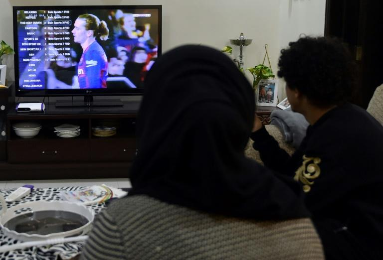 A family dodges an embargo by watching Qatar's beIN Sports channel at their home in the Saudi capital Riyadh (AFP Photo/FAYEZ NURELDINE)