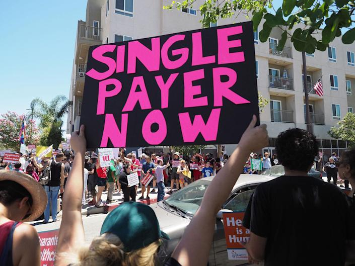 <p>People rally in favor of single-payer healthcare for all Californians as the US Senate prepares to vote on the Senate GOP health care bill, outside the office of California Assembly Speaker Anthony Rendon, June 27, 2017 in South Gate, Calif. (Photo: Robyn Beck/AFP/Getty Images) </p>