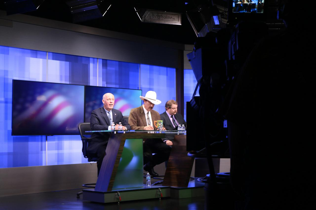 The three candidates, Republican Greg Gianforte, from left, Democrat Rob Quist and Libertarian Mark Wicks vying to fill Montana's only congressional seat take part in a televised debate ahead of the May 25 special election, Saturday, April 29, 2017, in Great Falls, Mont. The candidates tackled a wide range of topics, including guns, abortion, health care and money. (AP Photo/Bobby Caina Calvan)