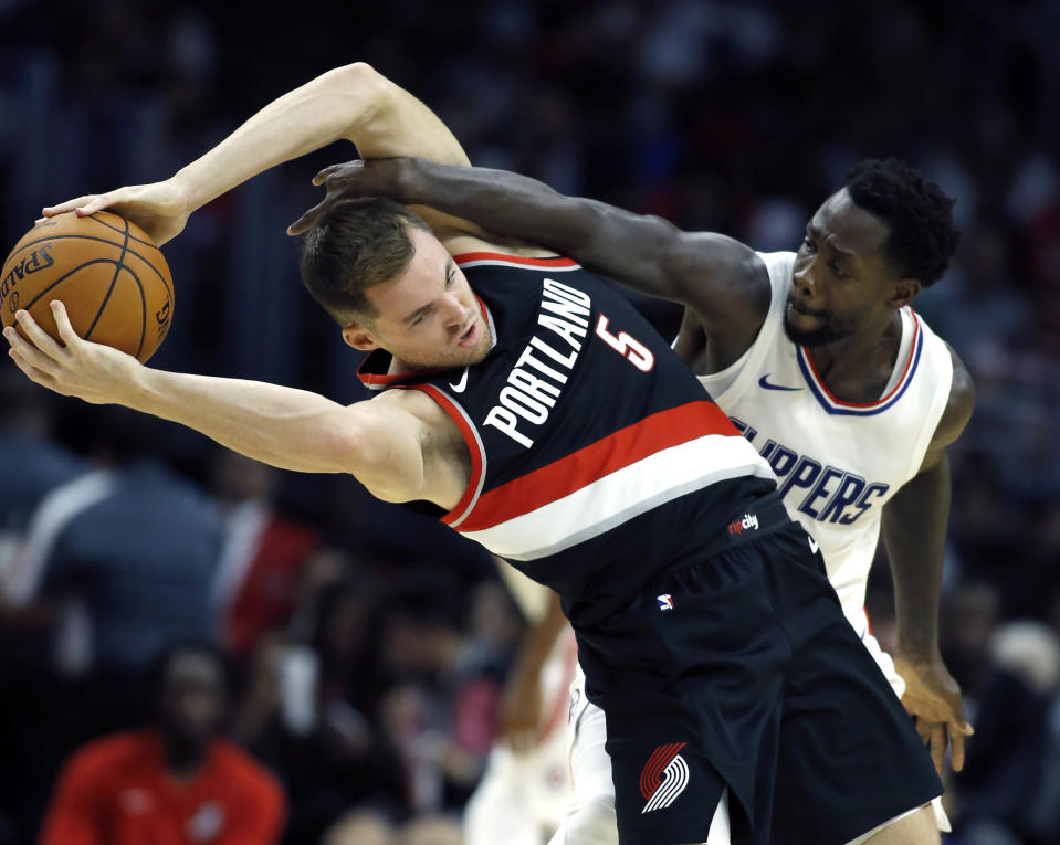 Patrick Beverley will bring his, um, aggressive brand of defense to Staples Center this season. (AP)