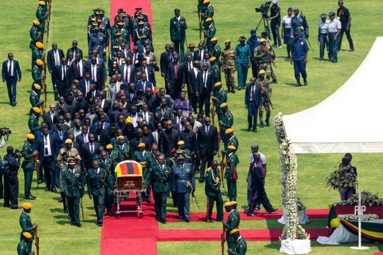 African leaders and officials from Cuba, Russia and China lauded Mugabe as a colonial-era guerilla icon (AFP Photo/Jekesai NJIKIZANA)
