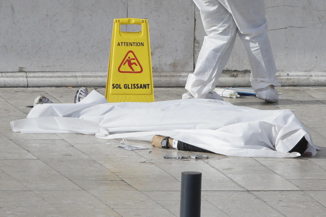 <p>An investigative police officer works by a body under a white sheet outside Marseille 's main train station, Oct. 1, 2017 in Marseille, southern France. A man with a knife attacked people at the main train station in the southeastern French city of Marseille on Sunday, killing two women before soldiers fatally shot the assailant, officials said. (AP Photo/Claude Paris) </p>