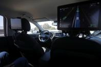 An empty driver's seat is seen inside a vehicle equipped with Pony.ai's self-driving technology during a demonstration in Fremont