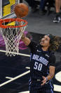 Orlando Magic guard Cole Anthony makes a shot against the Charlotte Hornets during the first half of an NBA basketball game, Monday, Jan. 25, 2021, in Orlando, Fla. (AP Photo/John Raoux)