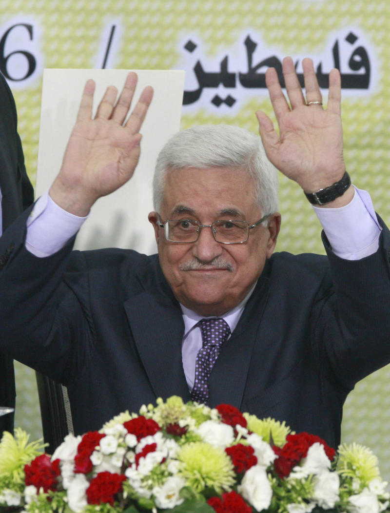 Palestinian President Mahmoud Abbas gestures during  a meeting of the Fatah movement Revolutionary Council  in West Bank city of Ramallah Wednesday, Oct. 26, 2011. International mediators sat down with Palestinian and Israeli officials in Jerusalem on Wednesday in the hope of finding a formula to restart deadlocked peace talks.  (AP Photo/Nasser Shiyoukhi)