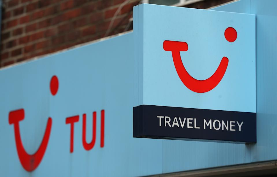 A sign for a Tui store