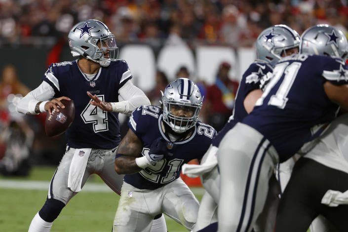 Dallas Cowboys quarterback Dak Prescott (4) looks to pass against the Tampa Bay Buccaneers during the first half of an NFL football game Thursday, Sept. 9, 2021, in Tampa, Fla. (AP Photo/Scott Audette)