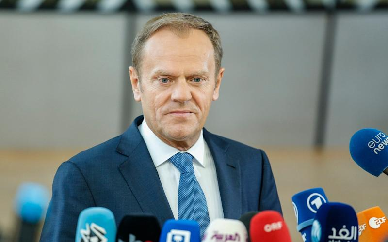 Donald Tusk speaks to the media as he arrives for a special European Summit in Brussels on Saturday - Credit:  JULIEN WARNAND/EPA
