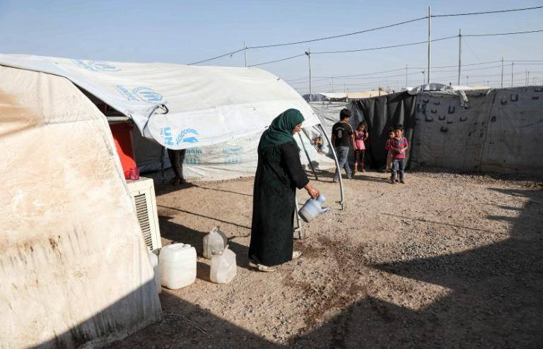 Mosul's migration office says up to 25 families a day are leaving their destroyed homes toreturn to displacement camps to access better services