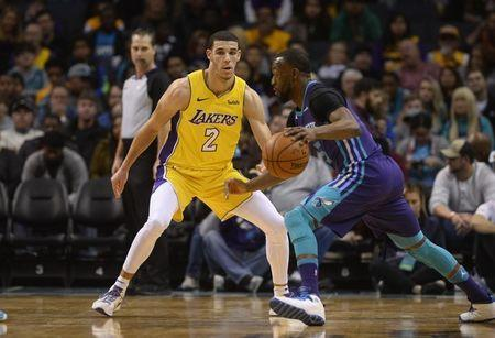 Dec 9, 2017; Charlotte, NC, USA; Los Angeles Lakers guard Lonzo Ball (2) defends Charlotte Hornets guard Kemba Walker (15) during the first half at the Spectrum Center. Sam Sharpe-USA TODAY Sports