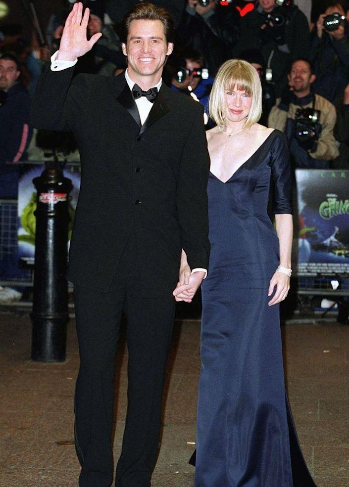 <p>Jim Carrey and Renée Zellweger looked polished in a classic tux and navy gown as they made their way to the reception line to meet the Queen at Carrey's film, <em>The Grinch</em><em>.</em></p>