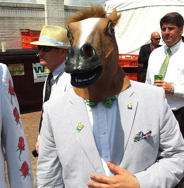 A spectator wearing a horse mask at the 138th Kentucky Derby horse race at Churchill Downs Saturday, May 5, 2012, in Louisville, Ky.