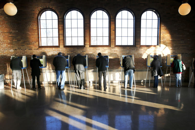 FILE - In this April 5, 2016, file photo, Wisconsin voters cast their ballots in the state's primary at the South Shore Park Pavilion in Milwaukee. A judge's ruling to purge up to 234,000 voter registrations in swing state Wisconsin had Democrats vowing Monday, Dec. 16, 2019 to double down on efforts to make sure anyone kicked off the rolls is able to re-register before the 2020 presidential election. (AP Photo/Charles Rex Arbogast, File)